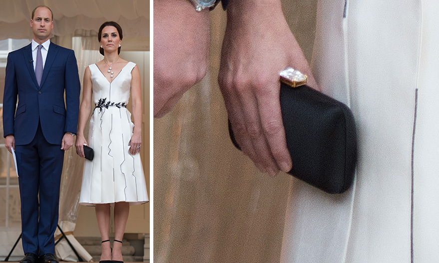 For a party in Poland, Kate chose a dress by a new designer in her wardrobe, Gosia Baczynska, and a classic fave, <b>Prada</B>, for her elegant clutch in black with a gem closure.