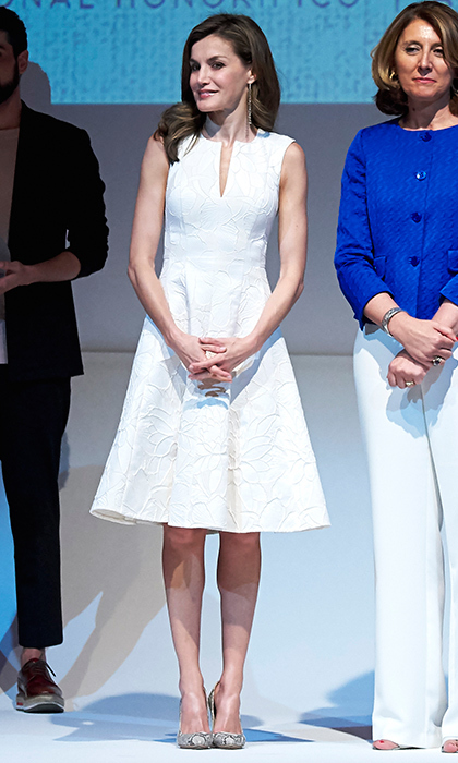 Queen Letizia wore summer's hotest style – the little white dress, this time by Carolina Herrera – to the National Fashion Awards 2017 at the Costume Museum in Madrid, Spain. 