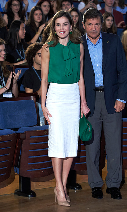Queen Letizia donned one of her favorite wardrobe pieces, a pencil skirt, with a pussy bow blouse in green and purse to match. The monarch's wife was at the opening of the International Music School's summer courses in Oviedo, Spain on July 21.