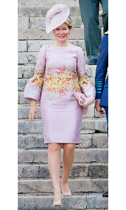 Queen Mathilde looked lovely in a watercolor bloom print Natan dress with bell sleeves as she joined the royal family for Belgium's National Day.