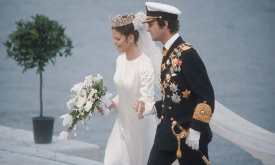 During the 1970s, many royal brides opted for more pared down looks. Queen Silvia chose a simply cut white dress with long sleeves for her wedding on June 19, 1976.