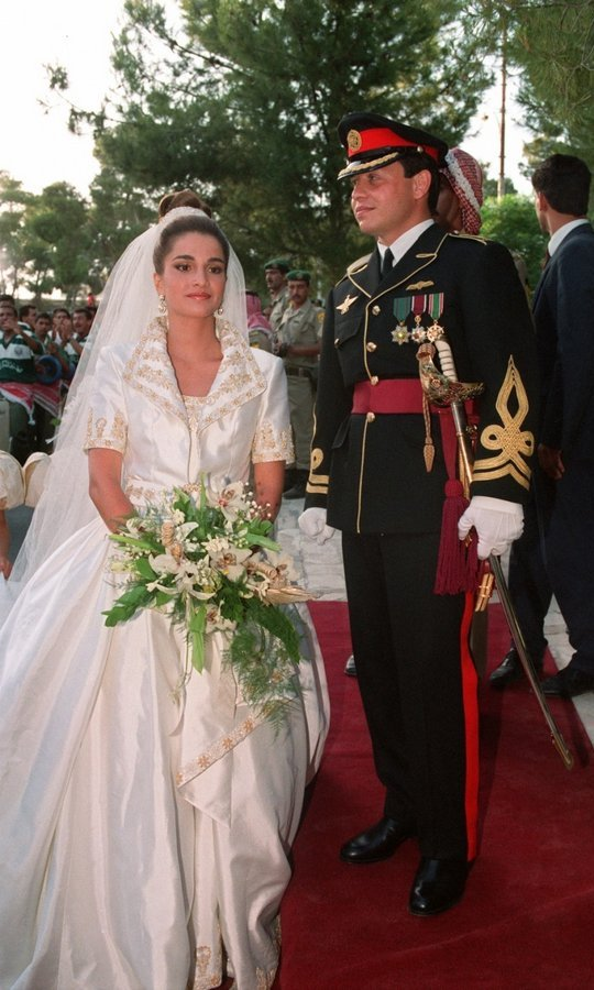 Twelve years after Diana and Charles, a 28-year-old now-Queen Rania was the perfect princess bride as she walked down the aisle toward King Abdullah at the Royal Palace in Amman on June 10, 1993.