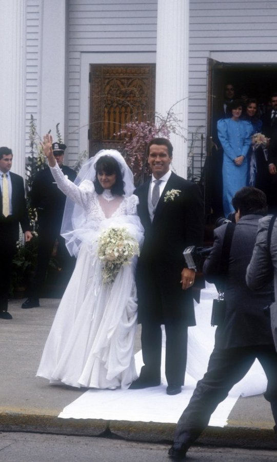 Celebrities also found the allure in head-turning gowns made with endless amounts of of silk and lace and accessorized with statement veils. While Arnold Schwarzenegger was an internationally known actor, new wife Maria Shriver really was the star in her gown with a long train during their wedding on April 26, 1986 in Hyannis, Massachusetts.