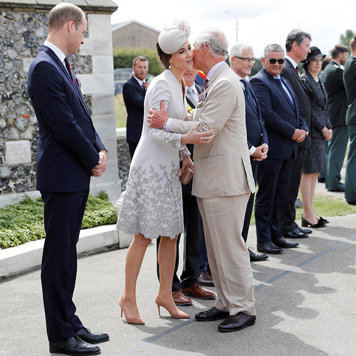 Prince Charles greeted daughter-in-law Kate Middleton with a kiss as he arrived ahead of a ceremony at Tyne Cot Cemetery on July 31 in Ypres, Belgium. The royals were in Belgium on a two-day royal visit to help mark the centenary of Passchendaele.
