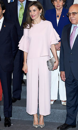 Queen Letizia looked pretty in pink attending a July 2017 meeting in Madrid wearing a ruffle-sleeved top and matching pants, each priced at $49.90, from <b>Zara</B>.