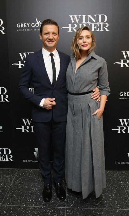 Stylish co-stars Elizabeth Olsen and Jeremy Renner attended the Weinstein Company with FIJI, Grey Goose, Lexus and NetJets screening of their film <i>Wind River</i> at The Museum of Modern Art in NYC on August 2. Elizabeth wore a long Dior coat dress while Jeremy kept things sharp in a tailored suit.