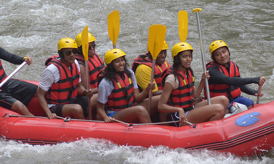 In June 2017, the former president, far left, and wife Michelle, seated to his left, wore matching helmets and lifejackets with Sasha, center, and Malia, second from right, for a rafting trip during their 10-day visit to Indonesia.