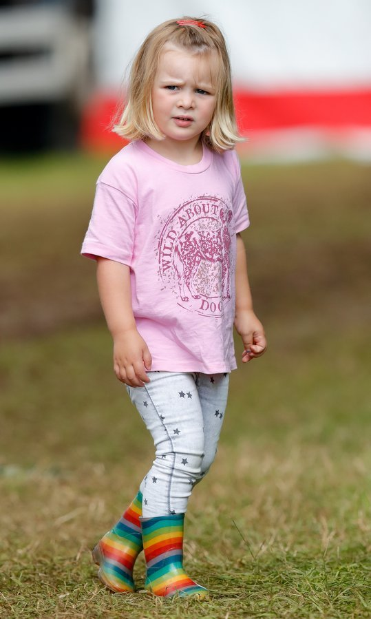 She may have been attending an equestrian event, but Queen Elizabeth's great-granddaughter Mia Tindall looked music festival ready in her adorable rainbow boots! The little royal was attending day one of the Festival of British Eventing at Gatcombe Park with her parents Mike and Zara Tindall on August 4 in Stroud, England.