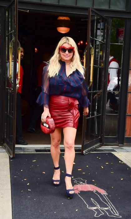 Red hot! Jessica Simpson lit up SoHo in NYC on August 8, when she stepped out in a bold ensemble. The 37-year-old was spotted in a red leather mini skirt paired with a blue striped blouse as she left the Bowery Hotel. She topped off the look with some fiery shades and an incredible lip-shaped purse!