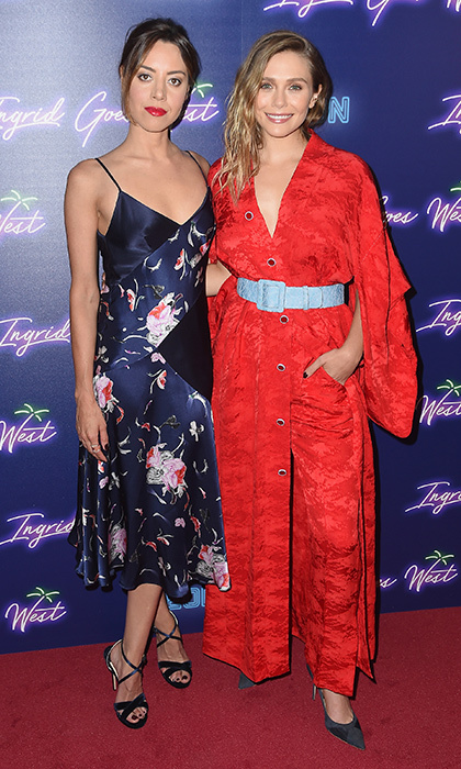 Silk pajama-inspired ensembles for the win! Aubrey Plaza wore a Prabal Gurung bias-cut floral lingerie dress and Elizabeth Olsen oped for a cool Rosie Assoulin robe for the New York premiere of <I>Ingrid Goes West</I> at Alamo Drafthouse Cinema on August 8. 