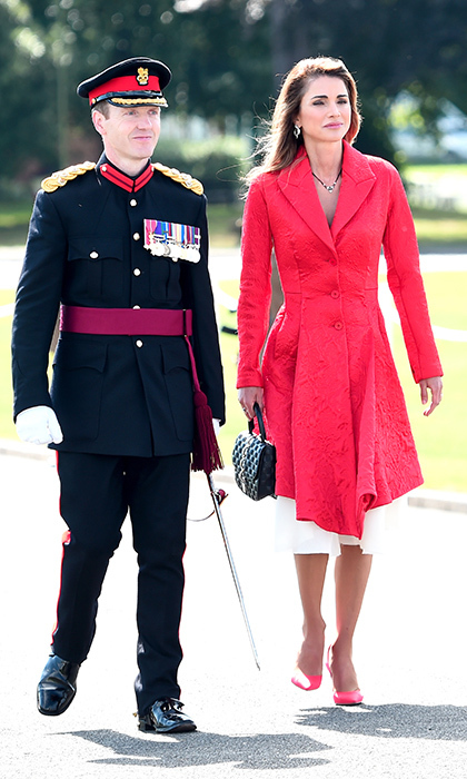 Queen Rania, the king's wife, was regal in red for the very special occasion. 