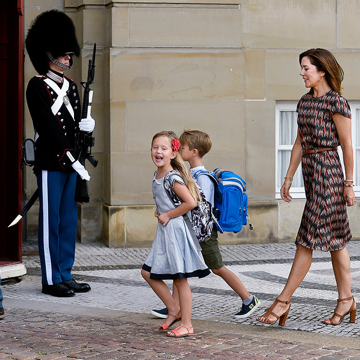 Followed by mom Crown Princess Mary in the courtyard of Amalienborg Castle – and joined by twin brother Prince Vincent – Denmark's Princess Josephine looked thrilled to be headed off for her first day of school on August 15. 