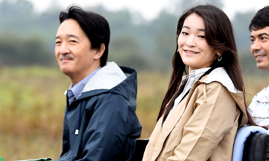 Princess Mako and her father Prince Akishino, who is second in line to the Chrysanthemum Throne, donned raincoats on day two of their unofficial visit to Hungary. 