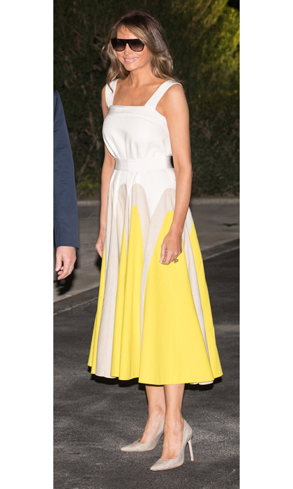 Melania Trump looked summer chic as she returned to the White House on August 20 after a 17-day working vacation wearing a white and yellow midi-length Delpozo frock that originally retailed for $2,300 but has since sold out.