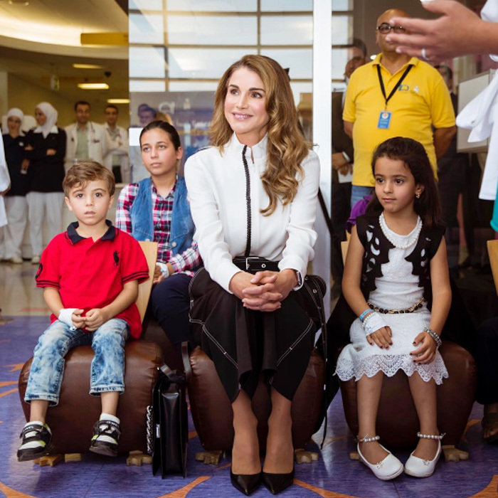 "Queen Rania of Jordan met with young boys and girls during her visit to the Queen Rania Al Abdullah Hospital for Children. Sharing a photo from the engagement, Her Majesty wrote, ""Thanks to the Children's Museum's Beyond Museum Walls project for bringing its hands-on learning activities to hospitalized children and others who cannot visit the Museum.""