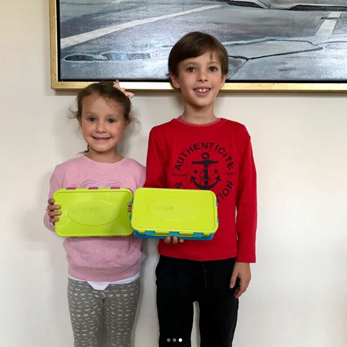 "Princess Marie's children, Princess Athena, five, and Prince Henrik, eight, posed with their lunch containers that their mom made from leftovers from their evening meal, which consisted of ""consisted of fish fillets and vegetables."" The mom-of-two noted, ""At home with us, we are very aware that nothing will be wasted.""