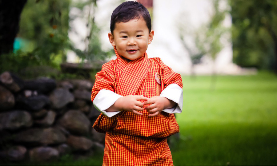 With a big smile on his face, HRH Gyalsey Jigme Namgyel posed in an orange frock in his family's garden. The image, which was taken in August 2017, is featured for the month of September in the Bhutanese website Yellow's calendar.