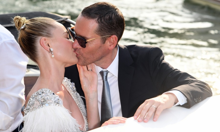 That's amore! Kate Bosworth and her husband Michael Polish shared a romantic Venice boat ride on the way to the actress' <i>Miu Miu Women's Tales</i> photocall on August 31. 
