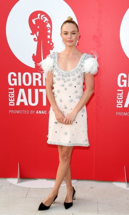 The 34-year-old opted for a Miu Miu dress, which featured feathers and silver embellishments. 