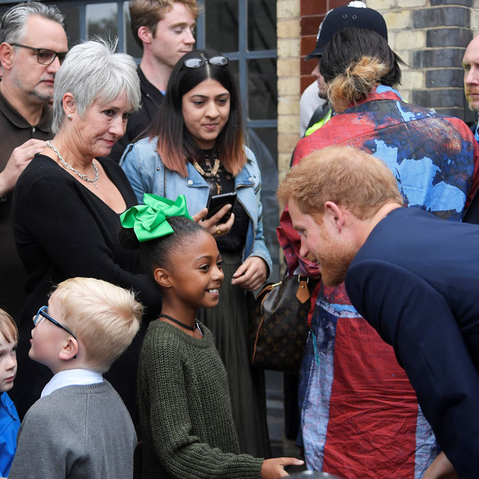 Prince Harry was his charming self as he met a little girl outside the September 5 visit to the newly established Royal Foundation Support4Grenfell community hub.