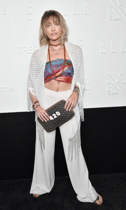 Paris Jackson flaunted her fresh chakras tattoo in a worldly bandeau top and long white pants, while at the E!, ELLE and IMG fashion week kick-off party. Guests at the party listend to music by DJ Kitty Cash and DJ Sinatra and sipped Ruffino Wine.