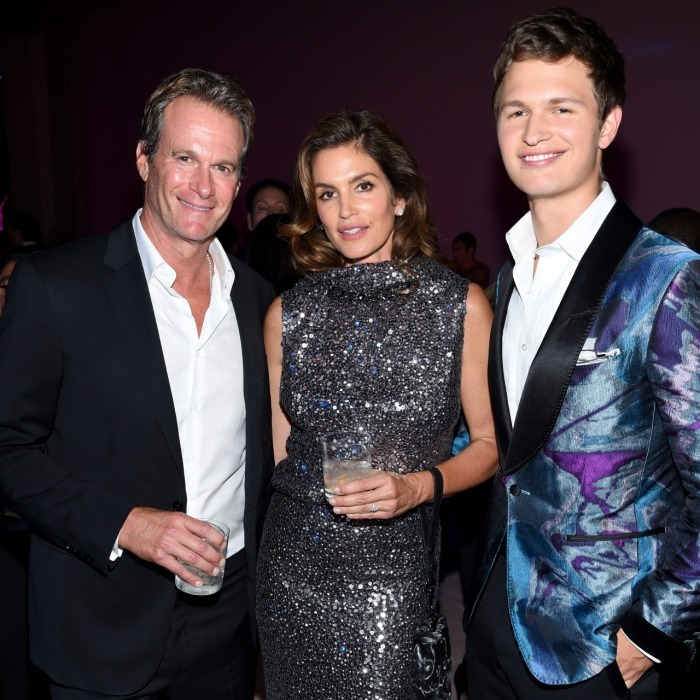 Ansel Elgort didn't mind third-wheeling with hot couple Rande Gerber and Cindy Crawford at the Tom Ford Spring/Summer 2018 Runway Show After Party on September 6. The <i>Baby Driver</i> star looked sharp in a purple-toned suit, as he stood next to the sparkling couple.