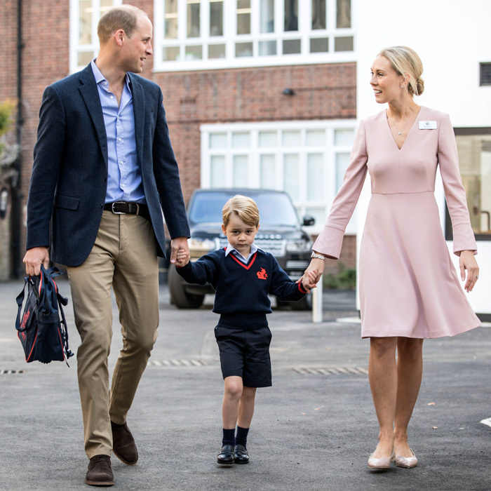 George held hands with his father and the school official as he made his way inside for his first day at Thomas's Battersea.