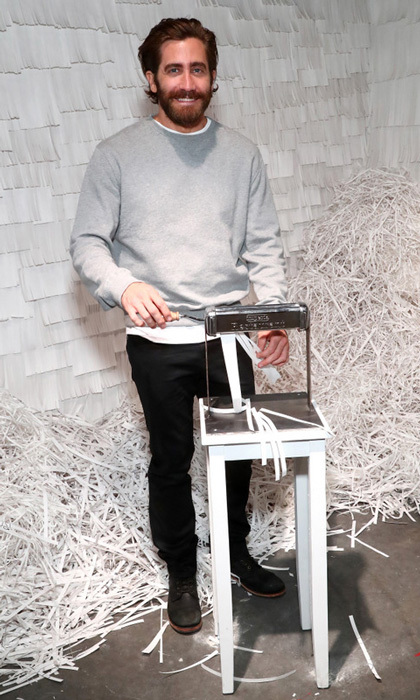 Jake Gyllenhaal couldn't resist shredding some of his own paper in one of the art installation rooms during Refinery29's 29Rooms Turn It Into Art party in Brooklyn, New York.