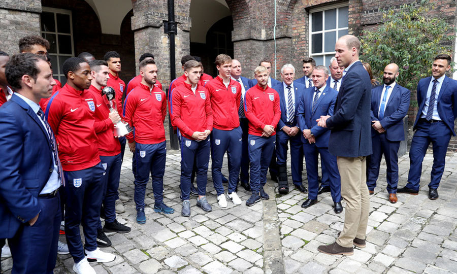 After dropping his son off at his first day of school, Prince William hosted a reception for the Under-20 England soccer team at Kensington Palace.