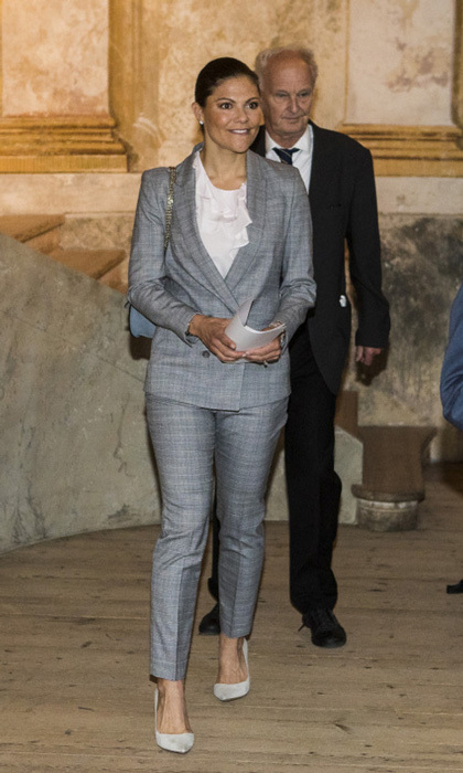 Crown Princess Victoria was all business in a grey suit while attending the Royal Colloquium 25th anniversary celebrations at Ulriksdal Palace Theatre on September 6.