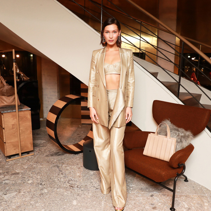 Bella Hadid was a golden goddess at the Max Mara Boutique reopening.