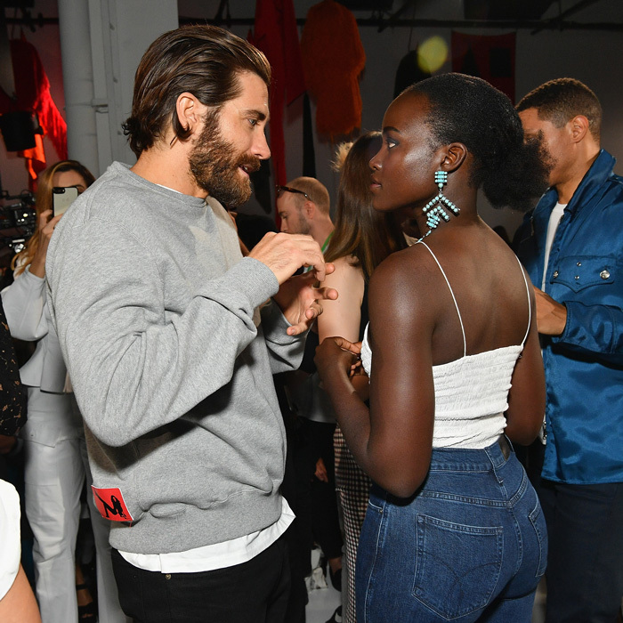 Jake Gyllenhaal and Lupita Nyong'o showed off their casual New York style at the Calvin Klein show.