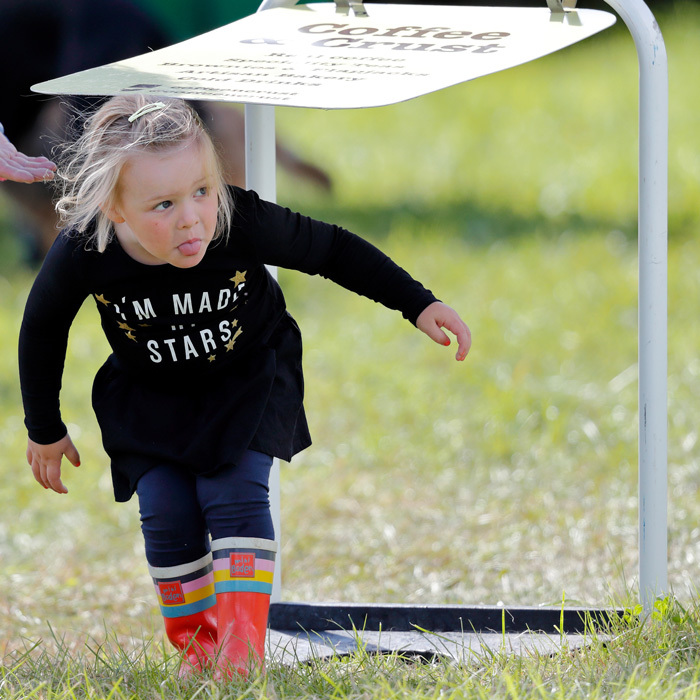 Mia Tindall took cover as she ran around the fields at Whatley Manor Horse Trials at Gatcombe Park on September 9, 2017.