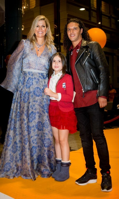 Queen Maxima of the Netherlands posed with Dutch rapper Ali B and a young girl during a benefit gala dinner for the Princess Maxima Center for children's oncology in the Concertbuilding on September 5. 