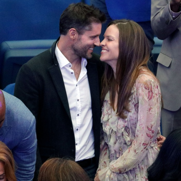 Hilary Swank and her boyfriend Philip Schneider brought their love to the stands as they watched the match with Emma and Billie. 