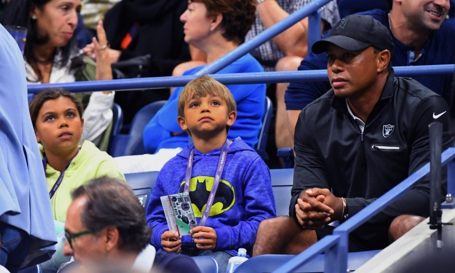 Tiger Woods had his two children - 10-year-old daughter Sam and eight-year-old son Charlie - by his side as he made his first public appearance since his DUI arrest in May 2017.