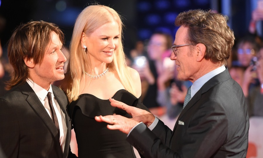 Keith Urban and Nicole Kidman were spotted chatting with Nicole's co-star Bryan Cranston at their much buzzed-about film <i>The Upside</i> at Roy Thomson Hall on September 8.
