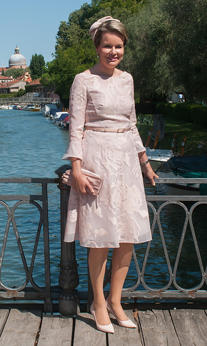 Queen Mathilde of Belgium looked sweet in head-to-toe powder pink during a visit to Venice on September 8.