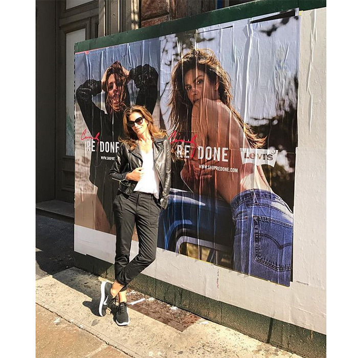 "Cindy Crawford took a moment to reflect next to this giant poster of her Levi's Re/Done campaign. ""Ran into a familiar face in SoHo. Excited to officially launch @shopREDONE tonight in NYC!"" she wrote alongside the September 12 Instagram post. 