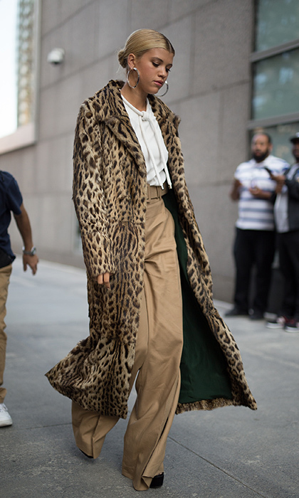 Sofia Richie showed her wilder side in a calf-length animal print coat. 