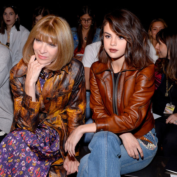 Selena Gomez showed she is ready for fall in a leather jacket and flared jeans next to Anna Wintour at Coach.