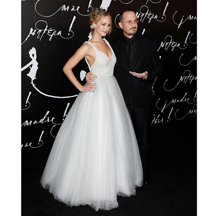 After keeping their distance from one another while promoting their new movie <I>Mother!</I>, Jennifer Lawrence and her boyfriend, director Darren Aronofsky, finally made their 'just the two of us' debut as a couple on the red carpet at the film's New York City premiere at Radio City Music Hall. The actress chose a ball gown by Christian Dior for the occasion.