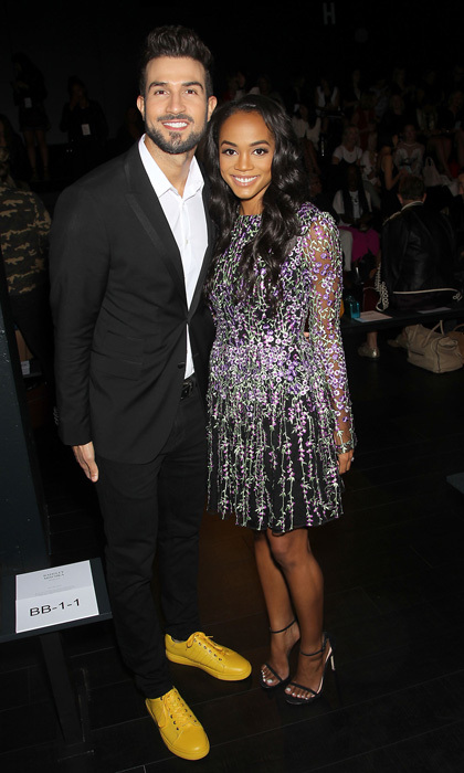 <i>Bachelorette</i>'s Rachel Lindsay and her fiancé Bryan Abasolo checked out the fashion during Badgley Mischka's runway show.
