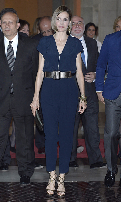 Queen Letizia of Spain rocked a jumpsuit with metallic accessories at the youth literary awards at The Real Casa de Correos in April 2015. 