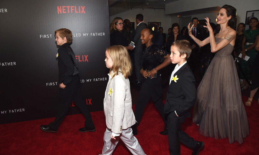 Angelia Jolie couldn't help but snap her own photo of this proud family moment with her kids Shiloh, Zahara, Vivienne and Knox on the <i>First They Killed My Father</i> New York carpet.