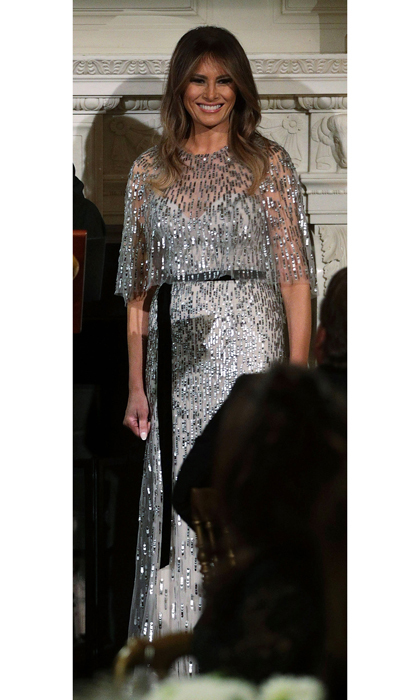 On September 14 in Washington, D.C., the First Lady helped host the White House Historical Association Dinner in a silver embroidered cape gown by Monique Lhuillier, which retails for $7,995.