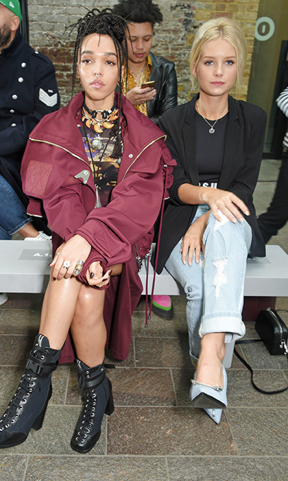 FKA Twigs, left, and Kate Moss' sister Lottie Moss sat front row for the Versus SS18 catwalk show.