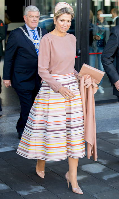 Before stepping out for the ballet and opera, Queen Maxima wore a striped A-line Natan skirt with a blush shirt to the  congress The Day of Youth Professionals in Utrecht, Netherlands.