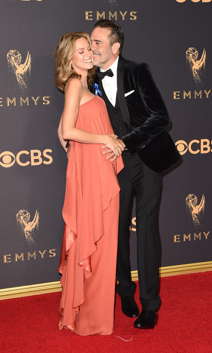 Hilarie Burton confirmed her and Jeffrey Dean Morgan's news that they are expecting their second child on the 2017 Emmys red carpet while wearing a tiered-Lanvin vintage dress.