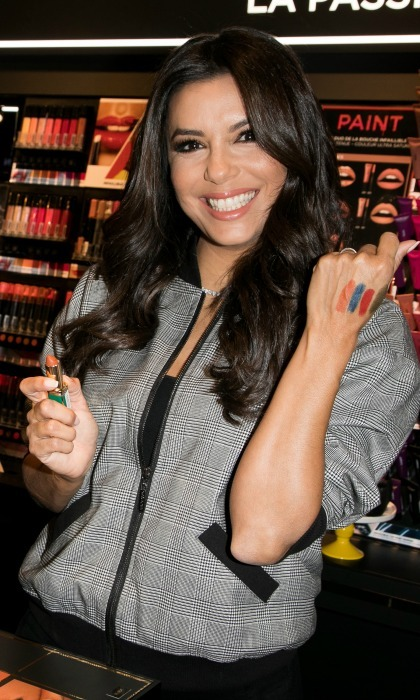 Swatch it! Eva Longoria had some fun with color during the L'Oreal meet and greet at L'OREAL Boutique on September 18 in Paris.